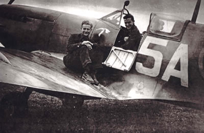 A photo of Douglas R Gist on wing and Bert Stinton in the cockpit.